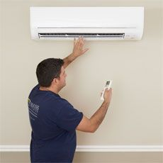 Mark Pauletti suing a remote to check airflow for How to Install a Mini-Split Heat Pump