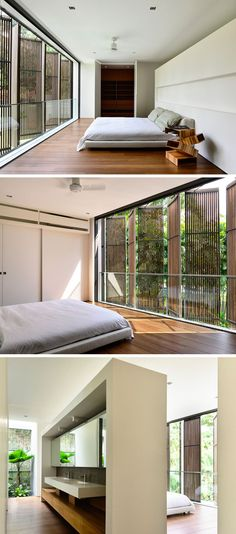This bedroom has wooden shutters on the window for privacy, and the back of the headboard becomes the bathroom.