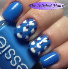 Blue Valentine Mani. This was my first try at hearts with a dotting tool. The turned out pretty good. :-) Polishes Used: China Glaze - White On White, Essie Avenue Maintain, Orly - Star Spangled & Sech Vite - Top Coat to finish.