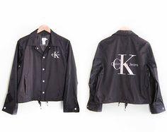 vintage windbreaker / Calvin Klein / spell out / 1990s Calvin Klein large logo coaches jacket Small