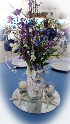 Sand Petal Weddings offers the convenient rental service of beach style centerpieces for ease to the traveling destination bride. Our numerous design style Beach Wedding Reception, Wedding Reception Centerpieces, Blue Beach, Light Purple, Mason Jars, Glass Vase, Table Decorations, Bride, Wedding Ideas