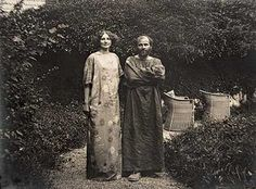 Klimt and a model in front of his studio.