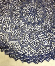 The Flower and Garden Shawl is a circular shawl or circular table cloth for an end table.