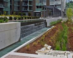 Fountain and bioswale at the Atwater Place mixed use development in the South Waterfront District, Portland, Oregon