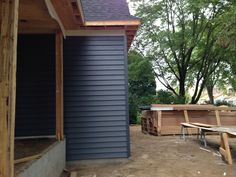 August 23, 2014 Siding started..Midnight Blue with White Trim