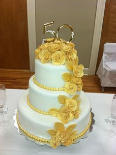 50th Wedding Anniversary Cake! The roses are made of gum paste/fondant and painted with edible gold paint.
