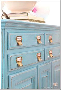 Reusing an old dresser for craft supplies - love identification handles