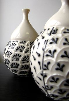 B&W; ceramic beauties. i'd love these filled with lush red roses, with the lids off to the side.
