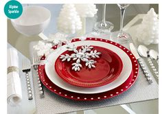 Hmmm.  Is this a start to a candy cane themed table?  Love the red charger, white plate and red salade plate.  Maybe add a white place mat and a red stripe table cloth???