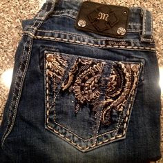 Miss Me jeans Flashy Miss Me jeans in great condition! Nothing missing on pockets, only missing two of the metal pieces on the leather tag on back. Miss Me Jeans