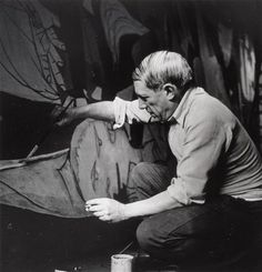 "rare photo of picasso at work.  here painting ""Guernica"". 1937"