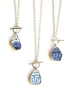 Pottery shard pendants by Tania, Moonflygirl