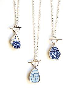 Pottery shard pendants by Tania, Moonflygirl