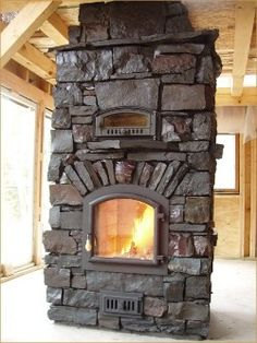 Masonry heaters are built of fire brick and utilize their high mass to radiate heat for the next 12-24 hours, a feature which means they only need to be fired once or twice per day. | North House Folk School