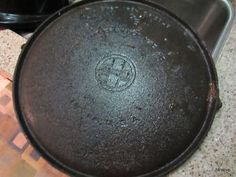 Several Methods to Clean Cast Iron. Easiest seems to be OVEN CLEANER which I plan to use for the crud on the outside of the pan. Good informative link.  | eBay
