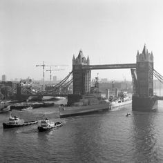HMS BELFAST takes up her moorings in the specially dredged berth in the Pool of London, 14 October 1971.