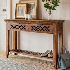 Console or hallway table made from hand waxed sheesham wood. With decorative shelf for display. With a carved design from our Jasmeen furniture collection in rosewood. Fair Trade. Hand made in India.