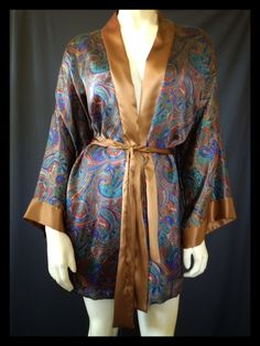 This silk robe was made in the early 90s but looks just as chic and elegant today as it did back then!    And guess what! We have an extra roll of this beautiful fabric and we want you to help us decide what to use it for! Comment here to let us know what type of limited edition website exclusive item you would like to see made from this silk satin. Cami/tap set? Chemise? Maybe even a maxi slip dress? It's up to you!