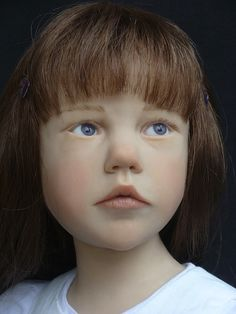 French artist Laurence Ruet creates amazingly life-like dolls that can almost pass for real children.     Sculpted without the use of a mould, these dolls are one-of-a-kind and spot unbelievably human expressions on their faces.  Absolutely amazing dollmaking art!
