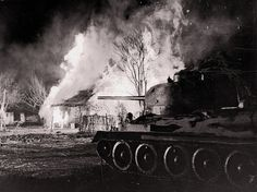 A Russian T-34 tank rolls through a burning village during the Battle of Kursk, July 1943. The battle took place when German and Soviet forces confronted each other on the Eastern Front. It remains both the largest series of armored clashes and the costliest single day of aerial warfare in history. It was the final strategic offensive the Germans were able to mount in the east. The resulting decisive Soviet victory gave the Red Army the strategic initiative for the rest of the war.