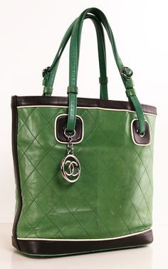 Chanel Quilted Green Tote - This color green is in all the trend reports right now! This casual tote features a brown interior lining with pockets, green leather handle straps, and dark brown leather trim with white piping.