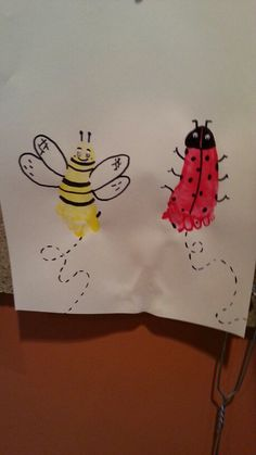 Fun spring finger paint art work for an infant. Done with a 4 month old I Nanny for. The black was added when the foot prints dry with a Sharpe.