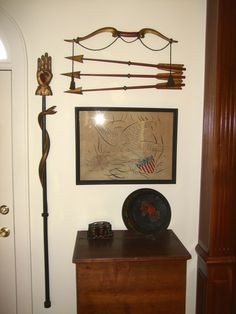 Heart in Hand Odd Fellows staff with a snake curling around the staff. . Bow and Arrows also IOOF. Really neat eagle.