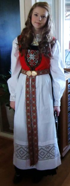 Hardanger bunad Girl listening to her ipod (notice left hand) in traditional dress