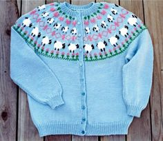 "Sheep Cardigan - Very cute, and we get lots of requests for this pattern alone! First you see the ""mamma"" sheep next to the flower garden. Then on up the sweater is a fence with baby sheep, then a row of ""loving hearts""! This is very cute done in pastels, but you can chose your own color combinations. Easily knit starting at bottom of body, then upwards to top and sleeves, ending at neck edge. $5.00"