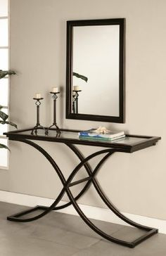 Southern Enterprises Inc. Vogue Sofa Table by Southern Enterprises. $201.28. Some assembly may be required. Please see product details.. Living Room->Coffee and Occasional Tables->Sofa Tables. Living Room. Contemporary Design Vogue Console Sofa Table. Southern Enterprises, Inc. Vogue Tables / Mirror... these modern, glass - top Tables are a gorgeous addition to any living room! The sleek curved design with a distressed finish will bring a unique, attractive flavor to your h...