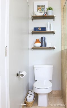 Add shelves over your toilet for extra storage and style in your bathroom Love this design idea and such an easy DIY project. Make the most of your space with these shelves.