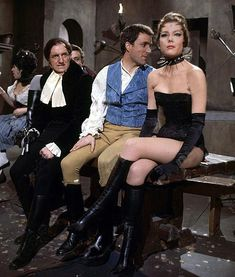 Diana Rigg --> The challenge in being Queen of Sin (other than tight corsets) is ignoring the bad crowd you're in with, as Mrs. Peel demonstrates with ignoble noblemen Roger Winthrop (Michael Latimer) and (l) Willy Frant (Jeremy Young). Emma Peel, Avengers Girl, New Avengers, Avengers Series, Diana Riggs, Dame Diana Rigg, Joanna Lumley, Fritz Lang, Elizabeth Montgomery