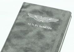 Brandbook paper journal for Aston Martin with velvet cover and hotfoil stamping