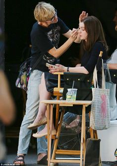 Time for a touch up: Anne gets a make-up session on set