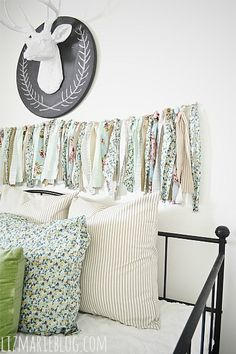 diy fabric garland, crafts, The DIY fabric garland hangs above our day bed in the guest bedroom