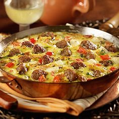tre formaggi fritatta.......In a large bowl, whisk the eggs, parmesan cheese and the pepper together. Set aside.