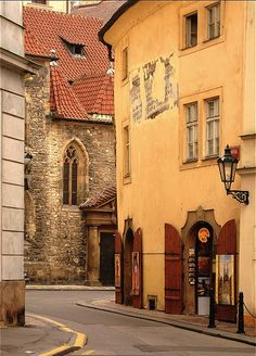 Medieval, Old Town Prague, Czech Republic. I've been in that little art shop. Its mostly folk art and very reasonable. Great folk art table linens.