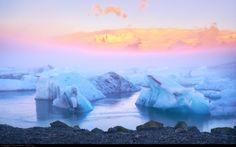 Iceland, Jokulsarlon glacier lagoon during a foggy sunrise