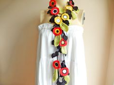 Feminine and stylish This crochet necklace scarf is made of soft cotton yarn and acrylic yarn. I knitted leaves and crochet flowers .I love very much poppies and daisies in spring. This scarf is perfect for ladies as well as tween/teen young ladies as well. You can wear it long, short,