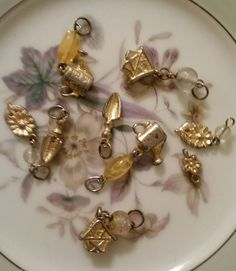 Charms garden themed gold tone