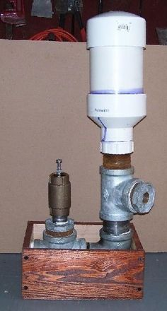 Build this Atlas Ram Pump. It can pump water from a flowing source of water to a point ABOVE that source with no power requirement other than the force of gravity.