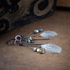 feather earrings • raw copper earrings • boho earrings • gipsy • tribal jewelry • glass beads • oxidized copper chain • cascade earrings by entre2et7 on Etsy
