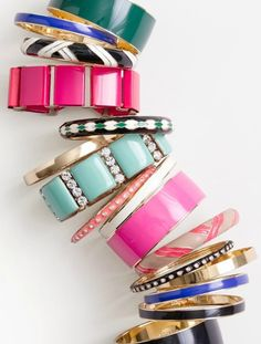 An assortment of jingle-jangle bangles.  #r29summerstyle