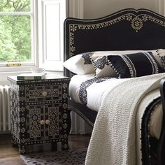 We're loving the ornate patterns on these pieces by Scotland-based esigner Niki Jones. The black-and-white furniture is hand-made by Rajast...