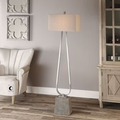Put the light right where you need it! Sublte and minimalist this floor lamp adds a glow without detracting from your decor. http://www.myswankyhome.com/carugo-polished-nickel-floor-lamp/