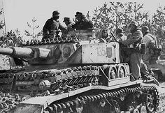 A Panzer 4 Ausf G with many added sections of track links for extra protection is providing a welcome rode to these lucky soldiers