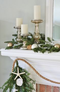 Coastal Christmas Mantel - Fresh greenery, with rope garland, starfish, sand dollars, and mercury glass. Beachy bliss!