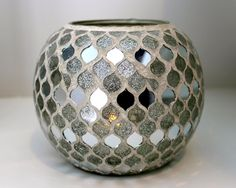 Pretty mirrored vase to add sparkle to any space! Silver & Sparkle Home Decor