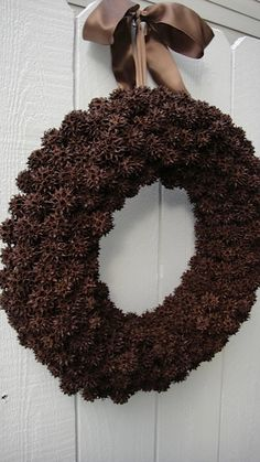 Sweet Gum Ball Wreath In October Brown. $80.00, via Etsy. ( I have the sweet gum tree right beside my fence and never thought to make a wreath with them ) (hang it so it doesn't tilt forward like the one in the pic. )