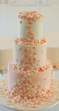 It looks like confetti is falling down this wedding cake!